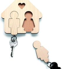 His and her keys and holder on the wall,  adorable