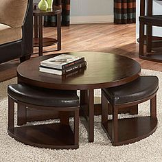 @Overstock - Baxter presents a charming cocktail table that comes with four wedge-size faux leather ottomans. This furniture set features a unique geometric circular design.http://www.overstock.com/Home-Garden/Baxter-Cocktail-Table-and-Faux-Leather-Ottomans-Set/4750524/product.html?CID=214117 $322.99
