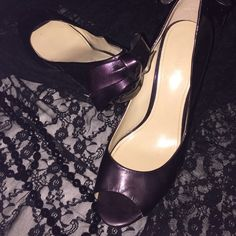 Eggplant patent leather peep toe heels Eggplant, dark purple patent leather heels with peep toe.  Show off a fun side with a lace-up patent leather bow on the heel.  Worn only a handful of times.  Nick on one heel shown.  Brand: Enzo Angiolini. Size 10M. Enzo Angiolini Shoes Heels