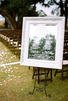 Brides: Romantic Calligraphed Mirror Ceremony Program. With custom calligraphy and a lacquered white frame, this gorgeous mirror display informs guests about the proceedings in a dazzling way.