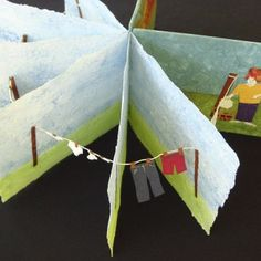 Linens and Things On Line by Sue Clancy - handmade Coptic-bound popup artists book with clothes line