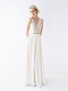 A structured deep-v gown with lace, rose gold sequins, and ruching