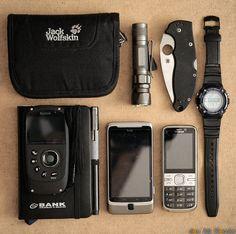 Back to black!  My current EDC:- Jack Wolfskin First Class Wallet- Kodak ZX5 Playsport - HD Camcorder- JETbeam Jet-1 PRO v.3 flashlight- Spy...
