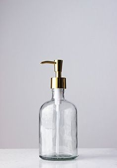 Clear Recycled Glass Soap Dispenser with Gold Pump Rail19 http://www.amazon.com/dp/B00XAHRCVA/ref=cm_sw_r_pi_dp_NvbKwb1TXBF0P