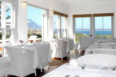 Ocean Eleven is an olde worlde, cape cod, colonial style guesthouse, with all encompassing sea-views of the bay, situated on the cliffs of Hermanus. Oceans 11, Wedding Function, 5 Star Hotels, Front Desk, Car Parking, Hotel Offers, Wi Fi, Public, House