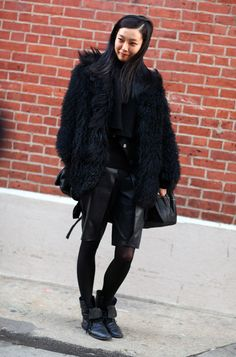 NewYork Street Style - The girl knows how to combine all black fashion gear for a winter look that screams color! Coat:  Black Furry Coat over Black Scarf  Shorts:  Black Leather Shorts  Shoes:  Black Boots --  Such a great Photo By:  Phil Oh