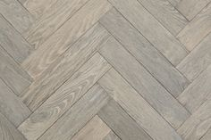 SILVER GREY. Our gorgeous silver grey oiled engineered oak herringbone parquet flooring. Modern and Luxury from Unique Bespoke Wood