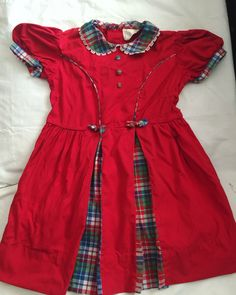 A personal favorite from my Etsy shop https://www.etsy.com/listing/182759471/vintage-fifties-girls-red-and-plaid