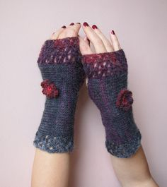 Feminine crocheted fingerless gloves...I love the rasberry red and violet color and the little rose