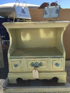 Really into this distressed yellow nightstand for sale by Shabby Restore (www.shabbyrestore.com) today at the Treasure Island Flea in San Francisco. #shabby #restore