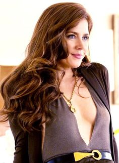 American Hustle - Amy Adams. My husband really wants to know where I can find similar outfits!