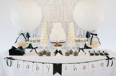 The dessert table was a gorgeous display of edibles that just called to be tasted. A sweet backdrop of sheer white cloth patterned with adorable black polka ...