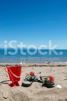 Kiwiana Christmas; Jandals with a Bucket and Spade royalty-free stock photo