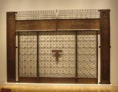 Louis Sullivan - Chicago stock exchange building.... I actually have one of the elevator head pieces .....