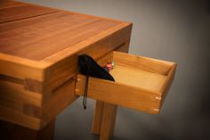GeekChic Hoplite table - The ends  are a good option for storage.