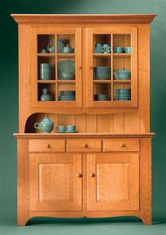 Classic Country Hutch American style and classic hardwood create a timeless treasure By Tim Johnson Tall and stately, this cupboard promises to be the focal point of any dining area. A functional wonder, it combines elegant display with spacious storage. For you as a builder, though, this cupboard is loaded with something quite different: advanced techniques that will challenge your woodworking skill. It has all the stuff to be your …