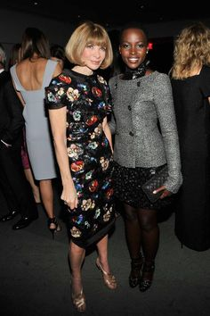 "Lupita with Anna Wintour (editor-in-chief of Vogue, USA) at the MoMA The Museum of Modern Art ""Film Benefit: A Tribute to Tilda Swinton."" Lupita looked so stunning in a CHANEL Fall 2013 Tweed Blazer and Couture Embellished High Neck Mini Dress.  Photo credit: Rob Kim/Getty — at MoMA The Museum of Modern Art."
