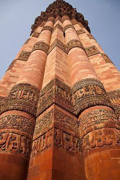 Qutub Minar, Delhi, India, is constructed of red sandstone and marble, and is the tallest minaret in India.
