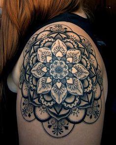 http://tattoomagz.com/shoulder-tattoos/geometric-flowers-shoulder-tattoo/