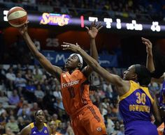 FILE - In this July 15, 2016, file photo, Connecticut Sun's Chiney Ogwumike, left, shoots past Los Angeles Sparks' Nneka Ogwumike, right, during first half of a WNBA basketball game in Uncasville, Conn. Chiney Ogwumike earned comeback player of the year honors, Tuesday, Sept. 20, 2016,  after recovering from microfracture surgery in her right knee.