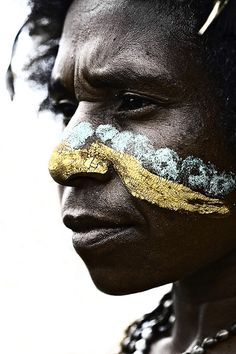 BeautySouthAfrica: Breathtaking photograph. Gold & silver face paint, Papua New Guinea