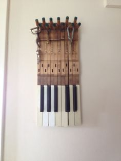 Keys on the keys,old piano keys used for hanging keys on the hammers at the top of each key.