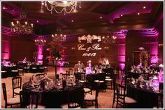 Pink ballroom with mood up-lighting, black linens, and projected monogram | villasiena.cc
