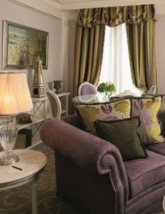 Corner suites at Hotel Balzac Paris with large sitting rooms and dining areas.