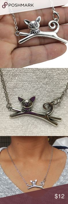 """Cat Necklace Cute silver toned zinc alloy necklace for a cat lover! Simple yet fun! Chain is about 18"""". It has a lobster clasp that clasp to the pendant like in the picture. New in package. Jewelry Necklaces"""