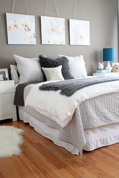 I love the hanging picture headboard... The simplicity of the entire room is beautiful