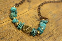 Adjustable in length this lovely brass and turquoise necklace from KathyGaiserJewels, $124.00