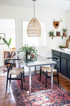 Boho Rattan Pendant Lighting Over Dining Room Table In Kitchen With Vintage Persian Rug Ashley Redmond