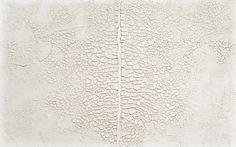 Alberto Burri: Grande bianco (Large White), 1971. Acrylic and PVA on Celotex. 126 x 201.7 cm. Private collection, United States. Photo: David Heald © Solomon R. Guggenheim Foundation, New York.