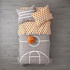 The Land of Nod Basketball Bedding is so great, it's ready to go pro. Made from comfy 100% cotton, the grey quilt is uniquely designed to resemble a basketball court. And the printed sheet set is made from 100% organic cotton.