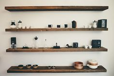 Wooden shelves - bracketless. Hmm. I might like these better for a cleaner look.