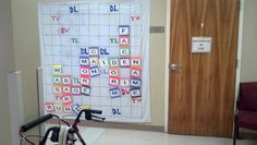 Life size scrabble board drawn on a shower curtain to use with pts. Great for cognition, dynamic standing balance, UE ROM... the possibilities are endless!! :-)