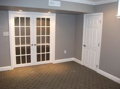 Textured carpet  French doors into family room to preserve natural light  Guest can drop shades on french door for privacy