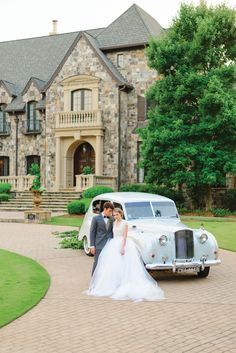Romantic bride and groom with a vintage classic car at a beautiful estate. Styling by Molly McKinley Designs, wedding dress by Chaviano Couture, necklace from Madewell, groom's attire from The Modern Gent, image by Rustic White at The Farm at High Shoals in Bishop, GA.