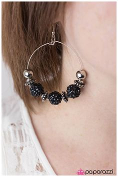 I Can Take a Compliment (Black)  Vintage-inspired beads and light-catching black rhinestone covered spheres are threaded along a thin silver hoop.   Sold as one pair of earrings.