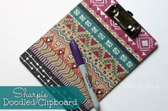 A lowly dollar store clipboard becomes something fun and trendy just by adding Sharpie doodles! #dollarstorecraft #sharpiecraft #officecraft