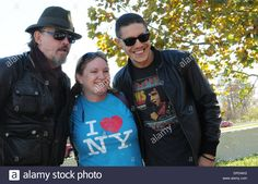 Download this stock image: Orlando, Florida, USA. 12th January 2014. Actors Tommy Flanagan (L) and Theo Rossi of the Sons of Anarchy American television drama series pose for a photograph with a fan at the Orlando Harley-Davidson store. Earlier, the actors served as grand marshals of the Bikers Against Child Abuse charity motorcycle ride from Walt Disney World. Over 2600 bikers participated in the event. Credit:  Paul Hennessy/Alamy Live News - DPD4KG from Alamy's library of million...