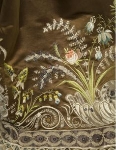 The embroidery on this satin dress circa 1810 caught my eye...You can see that the shells are embroidered with flat silk over a base of bobbinet. Isn't that lovely? I love this idea!