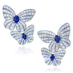 Cellini Jewelers Butterfly Earrings with Sapphires and Diamonds These Beautiful butterfly earrings, set in 18 karat white gold, feature 1.65 carats of oval cut rubies and 2.67 carats of round brilliant diamonds.