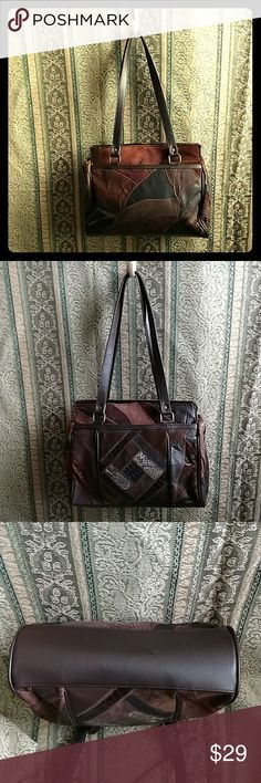 "Vintage Brown Patchwork Leather Purse This wonderful purse is in exceptional vintage condition! Inner divider with zipper, as well as additional zipped pocket inside. Outer pocket on each side. Leather with man-made trim. Purse zips completely closed. Height with straps 18.5"". Length 11"". Width opens to 4.5"". Bags Shoulder Bags"