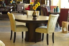 6-seater round dining table with textured top at The Green Door Company in Oxford, MS 662-380-5074