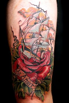 Pirate ship tattoo with rose done by Uncle Allen.