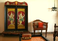 traditional south indian wooden prayer cabinet painted with figures of hindu gods and religious symbols