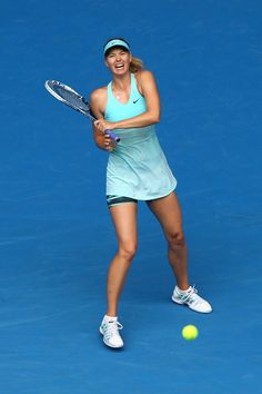 Maria Sharapova - 2014 Australian Open - Day 6.  Maria Sharapova of Russia plays a backhand in her third round match against Alize Cornet of France during day six of the 2014 Australian Open at Melbourne Park on January 18, 2014 in Melbourne, Australia.