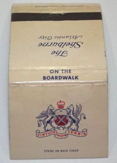 """The Shelburne Hotel. """"On The Boardwalk"""" Salt Water Baths Available. Vintage unused rear strike matchbook cover. Atlantic City, New Jersey. Entire Hotel Air Conditioned. Discoloration inside cover."""