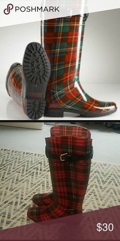Plaid Ralph Lauren rain boots it has some signs of wear but not noticeable because of the plaid design. good condition. very nice for rainy days. Ralph Lauren Shoes Winter & Rain Boots